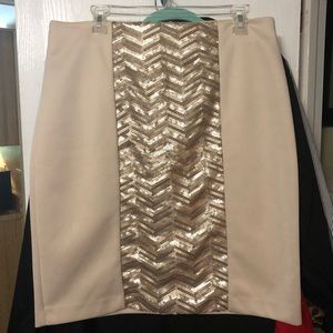 Cream and mixed metal sequined skirt.
